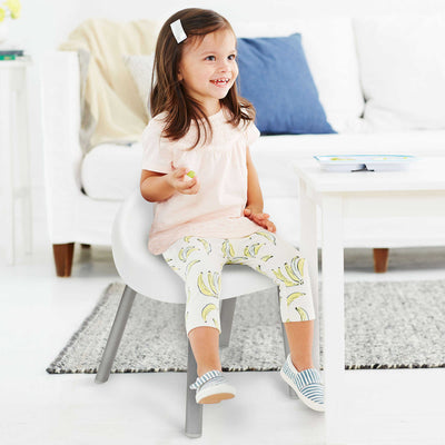 Little girl sitting on Skip Hop Explore & More Kid's Chair