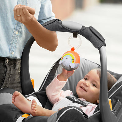Mom holding infant car seat with Skip Hop Grab & Go Car Seat Arm Pad
