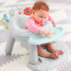 Baby eating in the Skip Hop Silver Lining Cloud 2-In-1 Activity Infant Seat