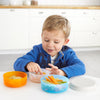 Boy eating on the Skip Hop Zoo Smart Serve Non-Slip Bowl Set in Dog