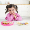 Girl eating with the Skip Hop Zoo Smart Serve Non-Slip Plates in Butterfly