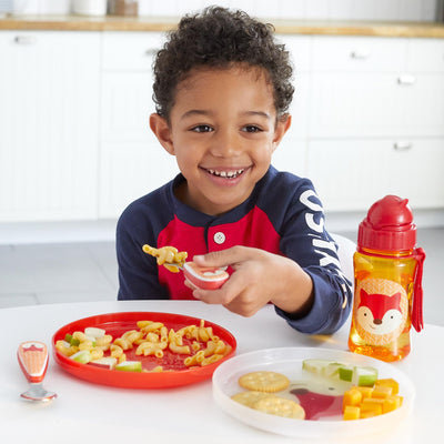 boy eating on the Skip Hop Zoo Smart Serve Non-Slip Plates in Fox