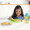 Girl eating on Skip Hop Zoo Smart Serve Non-Slip Plates in Giraffe