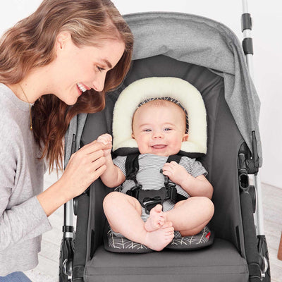 Baby sitting in stroller on Skip Hop Stroll & Go Cool Touch Infant Support in Grey Feather