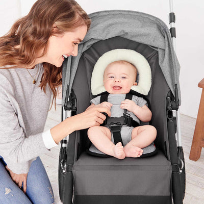 Baby sitting in stroller on Skip Hop Stroll & Go Cool Touch Infant Support in Heather Grey