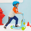 Boy scooting on the Skip Hop Zoo 3-In-1 Ride On Toy in Dog