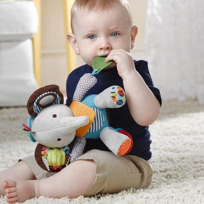 Baby playing with Skip Hop Banana Buddies Activity Animal in Elephant