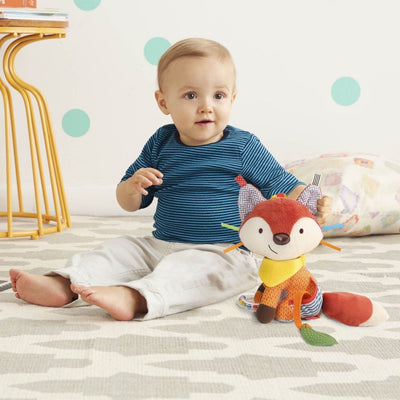 Baby playing with Skip Hop Banana Buddies Activity Animal in fox