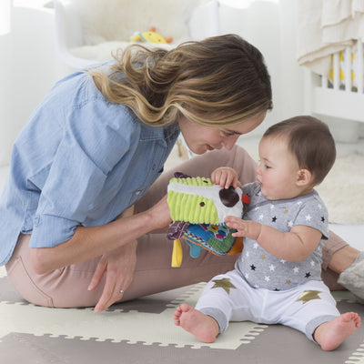 Mom and baby playing with Skip Hop Banana Buddies Baby Dog Puppet Book