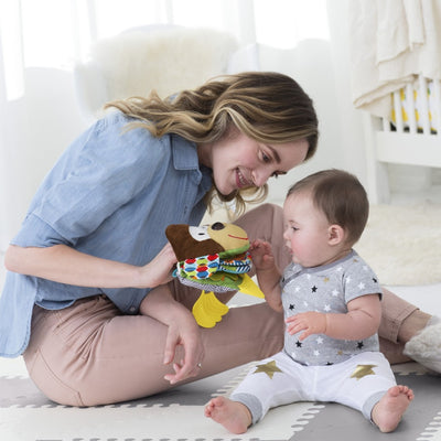 Mom and baby playing with Skip Hop Banana Buddies Baby Puppet Books