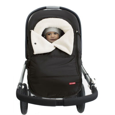 Skip Hop Stroll & Go Car Seat Cover in Black on car seat with baby sitting inside