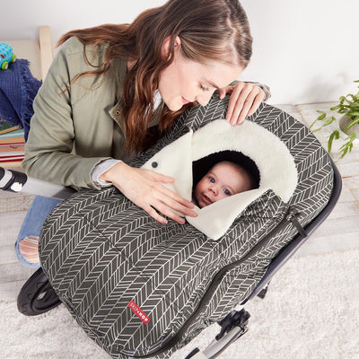 Skip Hop Stroll & Go Car Seat Cover in Grey Feather on car seat with baby sitting inside