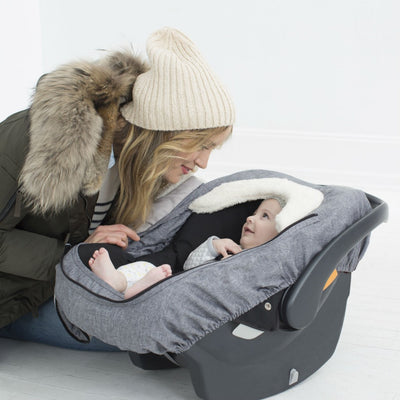 Skip Hop Stroll & Go Car Seat Cover in Heather Grey on car seat with baby sitting inside