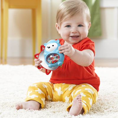 Baby playing with Skip Hop Explore & More Click Clack Hedgehog