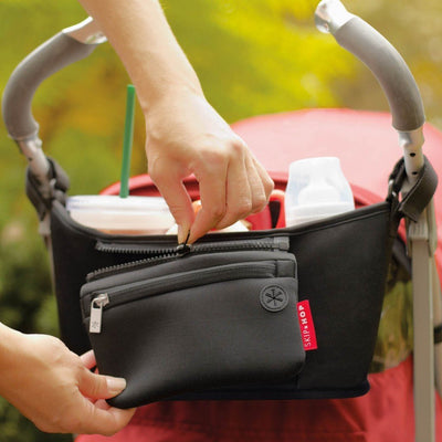 Mom zippering external pocket on the Skip Hop Grab & Go Stroller Organizer in Black