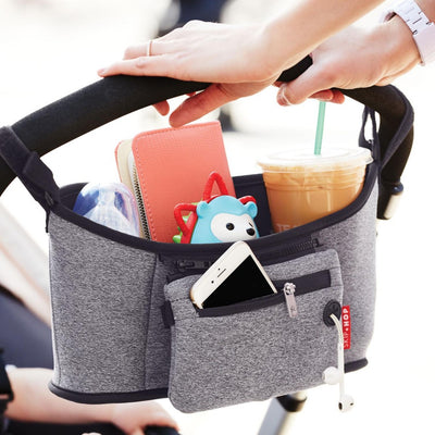 Skip Hop Grab & Go Stroller Organizer in Heather Grey attached to stroller handle