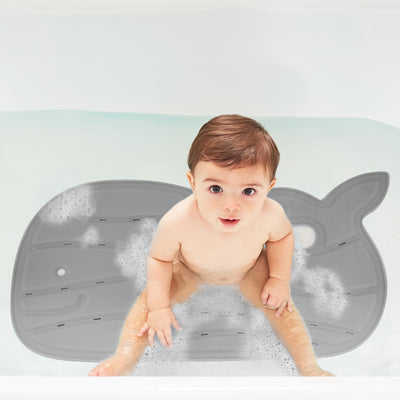 Toddler boy in the bath sitting on the Skip Hop Moby® Bath Mat in Grey
