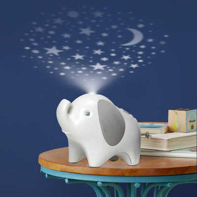 Skip Hop Moonlight & Melodies Elephant Projection Nightlight Soother projecting stars on the ceiling