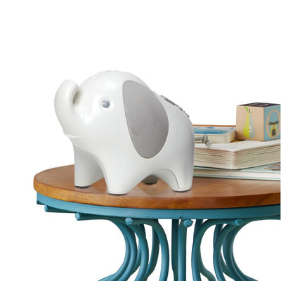 Skip Hop Moonlight & Melodies Elephant Projection Nightlight Soother on table