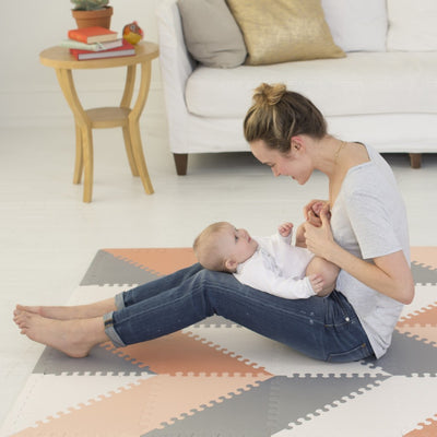 Mom and baby playing on Skip Hop Playspot Geo Triangular Interlocking Foam Floor Tiles in Grey and Peach
