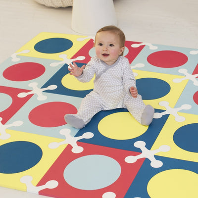 baby playing on Skip Hop Playspot Interlocking Foam Floor Tiles in multi mix