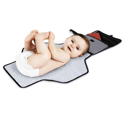 Baby lying on Skip Hop Pronto! Changing Station in Heather Grey