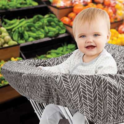 Baby sitting in shopping cart with Skip Hop Take Cover Shopping Cart & High Chair Cover in Grey Feather