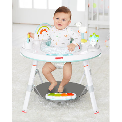 Baby sitting in Skip Hop Silver Lining Cloud Baby's View 3-Stage Activity Center