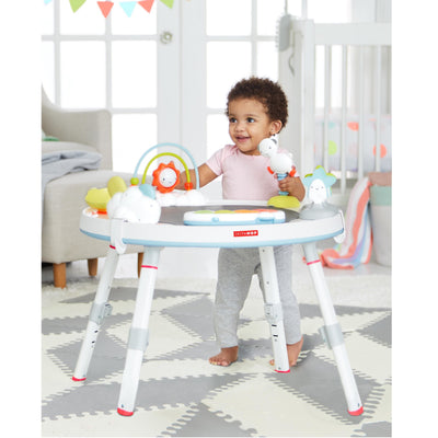 toddler playing on the Skip Hop Silver Lining Cloud Baby's View 3-Stage Activity Center