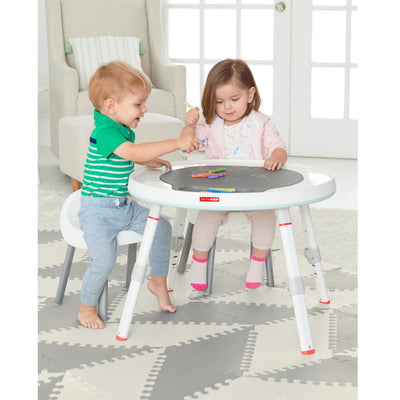 Children playing with Skip Hop Silver Lining Cloud Baby's View 3-Stage Activity Center as a table
