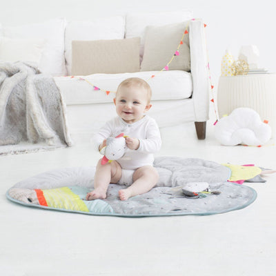 Baby playing on Skip Hop Silver Lining Cloud Baby Activity Gym