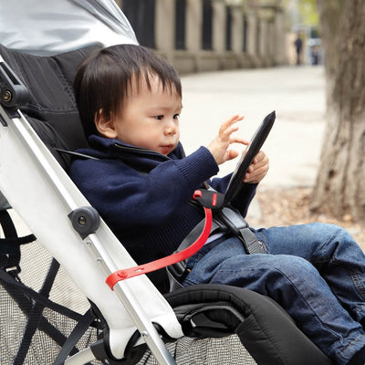 Baby playing with phone attached to stroller and in Skip Hop Stroll & Go Phone Tether