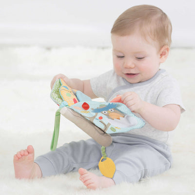 Baby playing with Skip Hop Treetop Friends Soft Activity Book