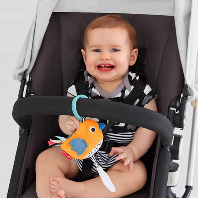Baby Playing With Skip Hop Vibrant Village Light Up Birdie Attached To Stroller Bar