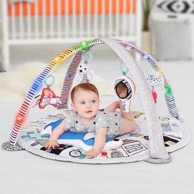 Baby playing on Skip Hop Vibrant Village Smart Lights Activity Gym