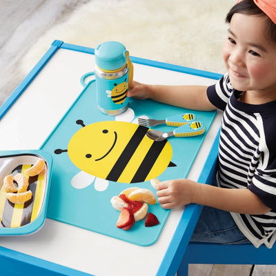 Boy eating with Skip Hop Zoo Fold & Go Silicone Placemat in Bee