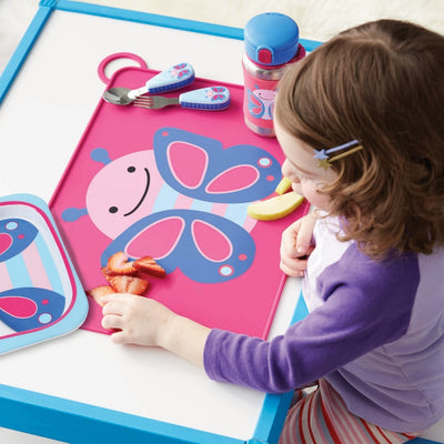 Girl eating on Skip Hop Zoo Fold & Go Silicone Placemat in Butterfly