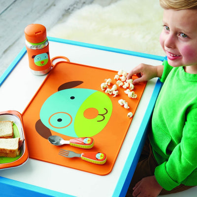 Boy eating on Skip Hop Zoo Fold & Go Silicone Placemat in Dog
