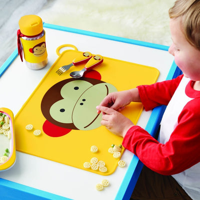 Boy eating on Skip Hop Zoo Fold & Go Silicone Placemat in Monkey