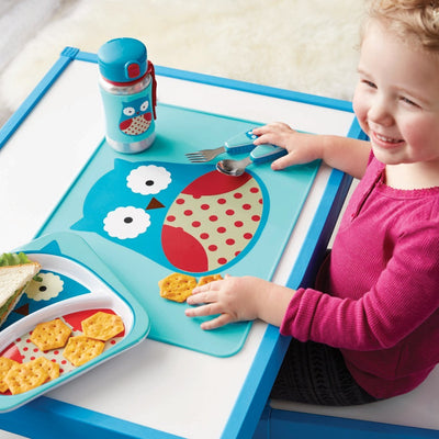Girl eating on Skip Hop Zoo Fold & Go Silicone Placemat in Owl