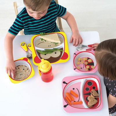 Two children eating on Skip Hop Zoo Tableware Melamine Plates in Monkey and Ladybug