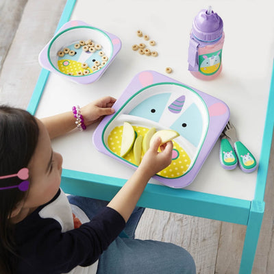 Little girl eating with Skip Hop Zoo Tableware Melamine Bowl and Plate in Unicorn