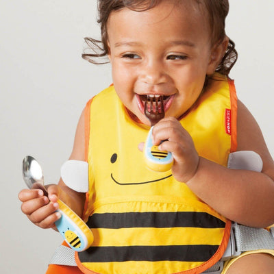 Toddler eating with Skip Hop Zootensils Fork & Spoon in Bee