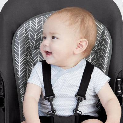Baby sitting in stroller on Skip Hop Stroll & Go Cool Touch Stroller Liner in Grey Feather