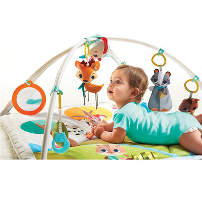 Baby playing on the Tiny Love Into the Forest™ Gymini® Deluxe