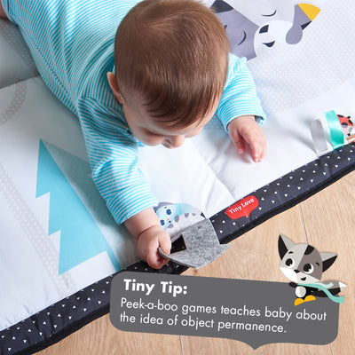 Baby playing on the Tiny Love Magical Tales Black & White Super Mat