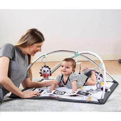Mom and baby with the Tiny Love Magical Tales Black & White Gymini®