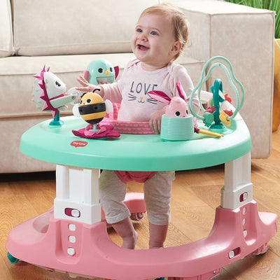 Baby playing in the Tiny Love Tiny Princess Tales™ 4-in-1 Here I Grow Mobile Activity Center