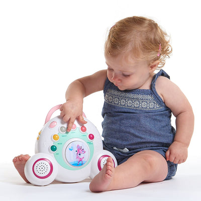 Toddler playing with the Tiny Love Tiny Princess Tales™ Soothe 'n Groove Mobile