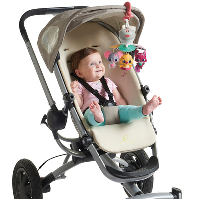 Tiny Love Tiny Princess Tales™ Take-Along Mobile attached to stroller